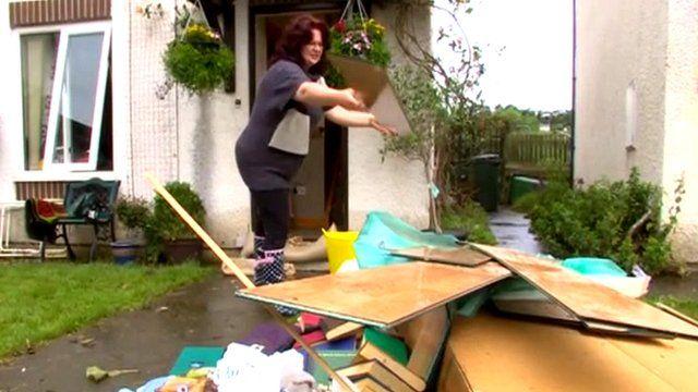 Householder with flood-damaged house