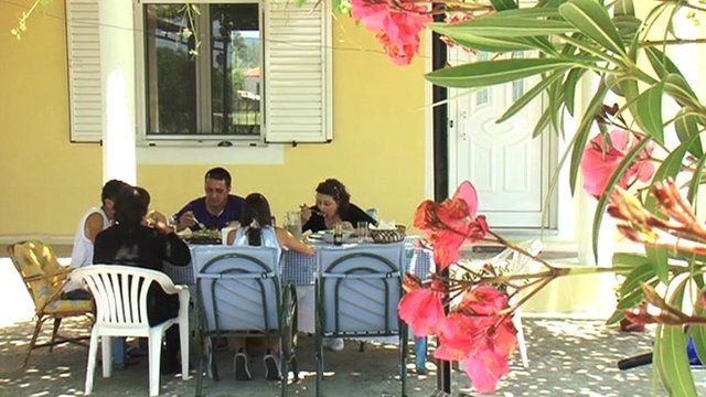 Greek family at dining table
