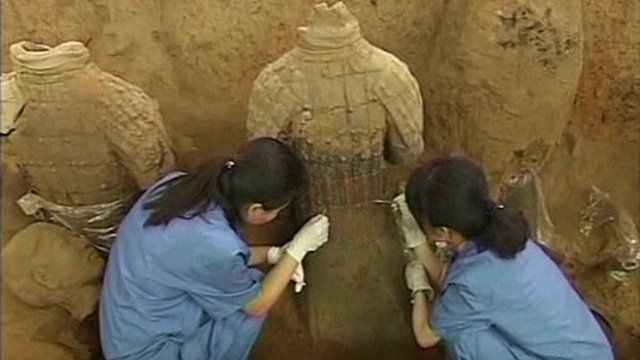 Archaeologists excavating a terracotta warrior