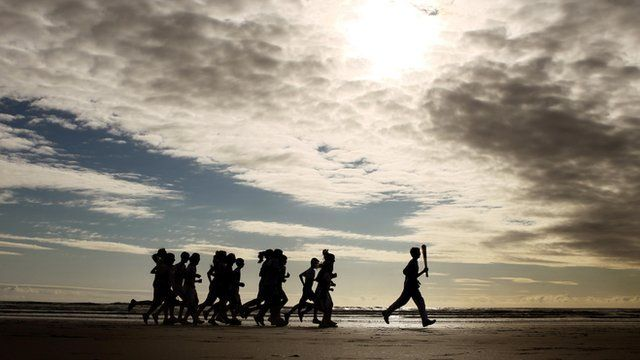 Thirteen-year-old Joseph Forester carries the torch on West Sands