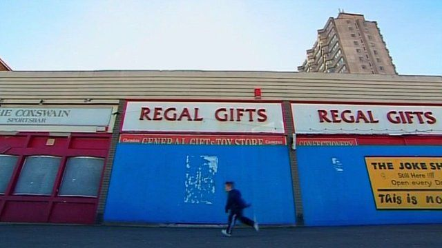A child walks past closed shops in Margate