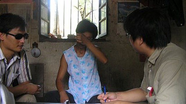 Chen Guangcheng visiting with a victim of a forced abortion