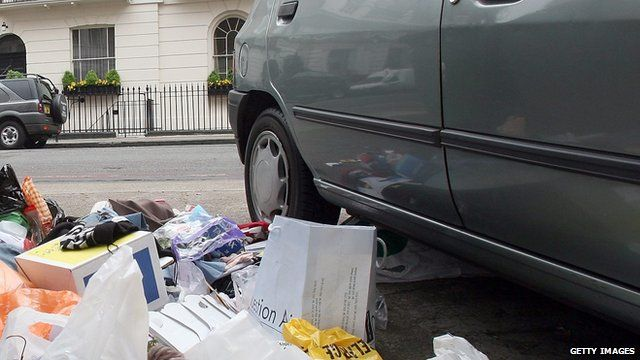 rubbish by the side of a car