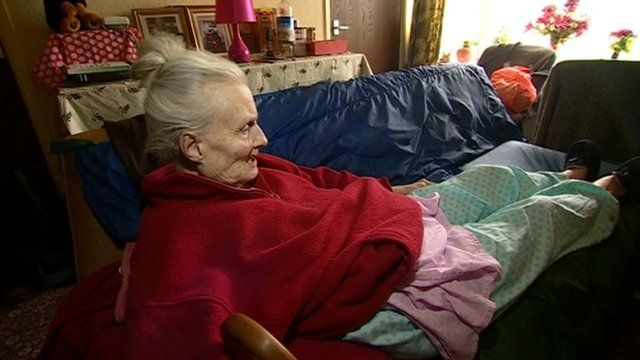 Audrey Pearce, 83, sleeps on the sofa of her disabled daughter's one-bedroom bungalow.