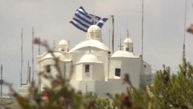 Greek flag flies on building