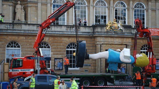 Two cranes being used to lift Charity onto a lorry