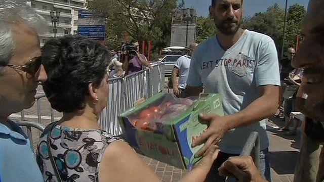 Greek woman receives free vegetable package