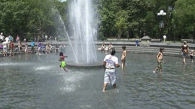 People cooling off in fountain in New York