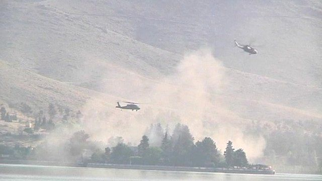 Helicopters circle over the Spozhmai Hotel