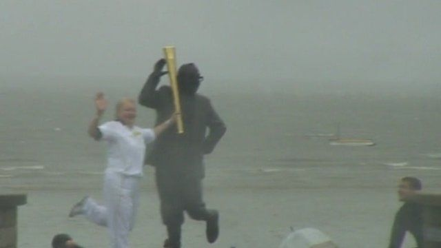 The Olympic torch in the rain