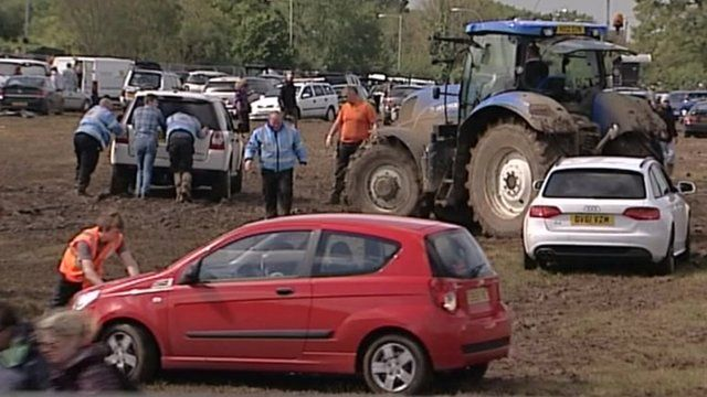 Cars stuck in the mud at the Isle of Wight Festival
