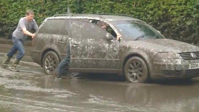 Car stranded in mud