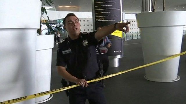 Policeman at the scene of a shootout in Mexico City's main airport.