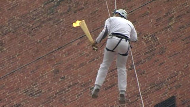 Olympic torch abseiled down Grimsby Dock Tower