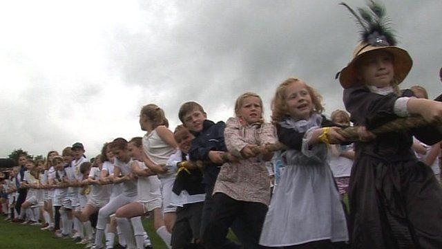 Children playing tug-of-war