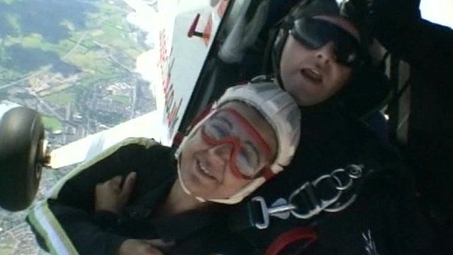 Paul Nicol (behind) in doing a tandem skydive