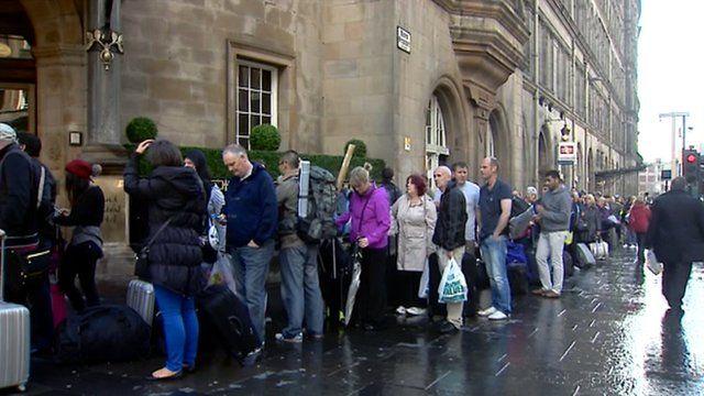 Rail passengers queue at Glasgow's Central Station