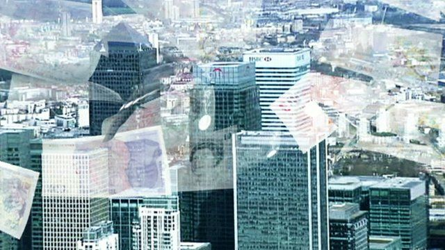 Banks in Canary Wharf with grapic image of money falling down