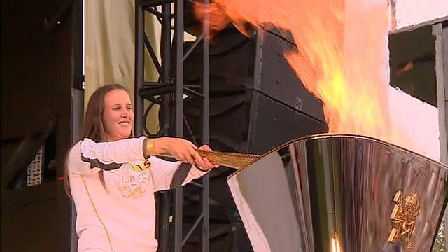 Nicky Hunt lights cauldron in Ipswich with Olympic flame