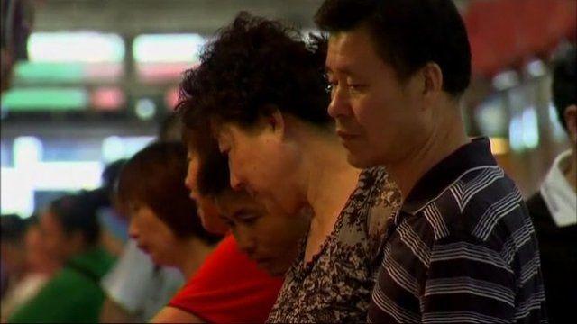 Shoppers at a Shanghai market