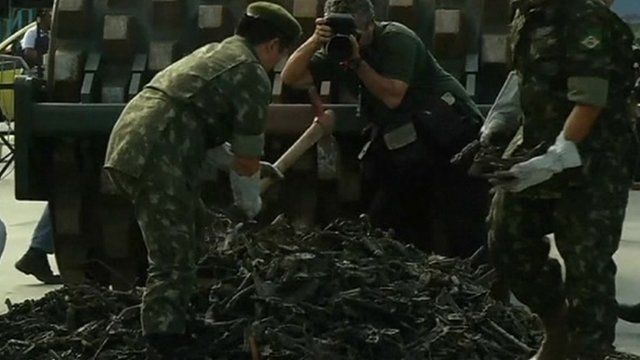 Soldiers destroying violent weapons