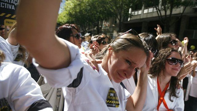 A doctor cries during a protest in front of the Health Ministry in Lisbon