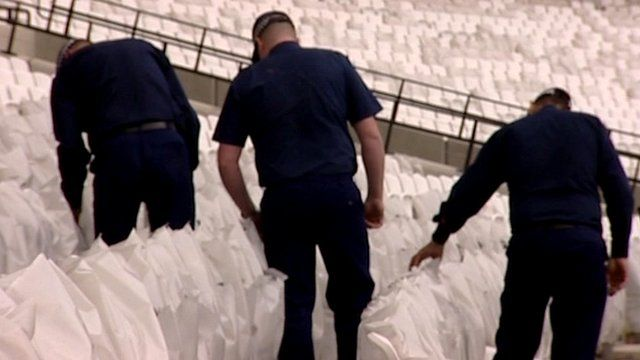 Security guards search stadium