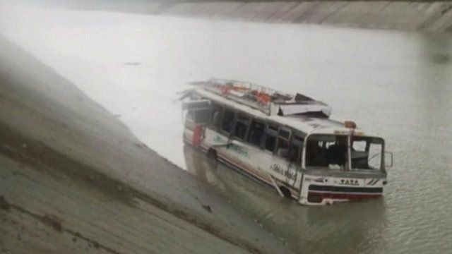 Bus partly submerged in a canal