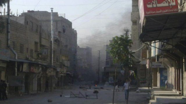 Demonstrators in the al-Tadamun area in Damascus on 15 July 2012