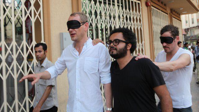 A blindfolded Christian Jankowski is shown around Dubai by Rami Farook