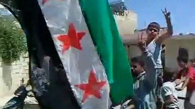 Still image from unverified footage purportedly shows people celebrating following the deaths of three Syrian officials