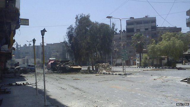 damaged tank on Damascus street
