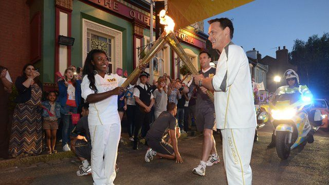 Billy lights the torch on the set of Eastenders