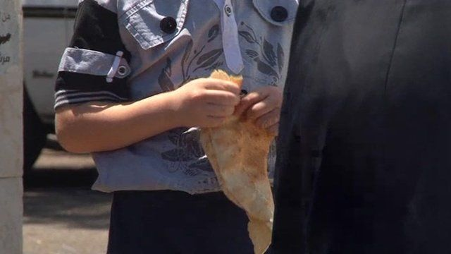 A child holds bread