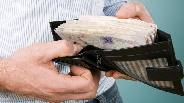 Man's wallet filled with cash