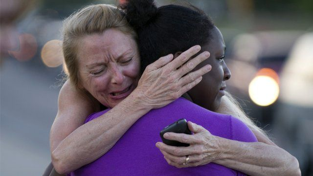 Mourners embrace in Aurora, Colorado