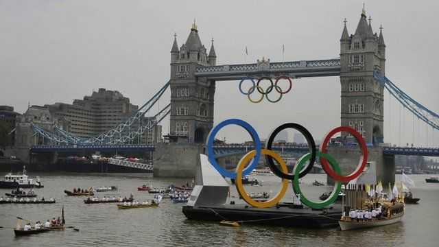 Olympic rings and royal barge on Thames