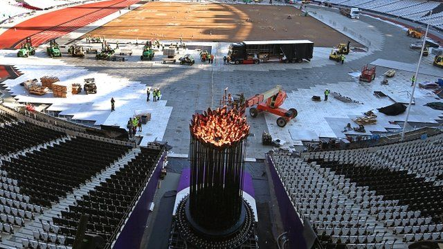 Olympic flame is repositioned in the stadium
