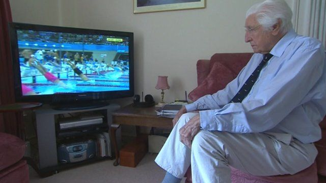 Bill Lucas watching TV