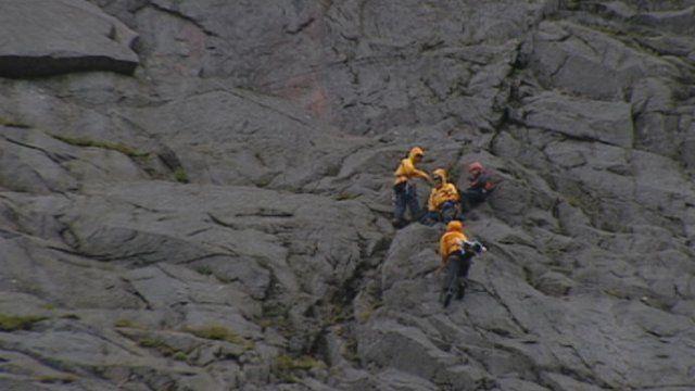 Mountain climbers on a rockface