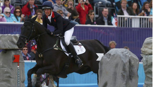 Nicola Wilson, riding Opposition Buzz, during the Eventing Jumping equestrian event at the London 2012 Olympic Games. REUTERS/Eddie Keogh
