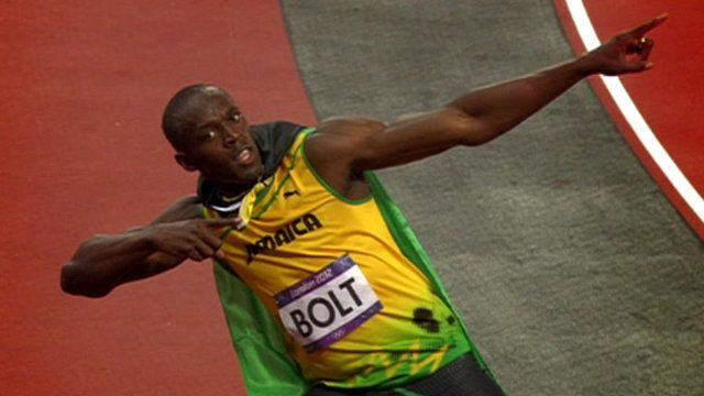 Usain Bolt celebrates his 100m gold