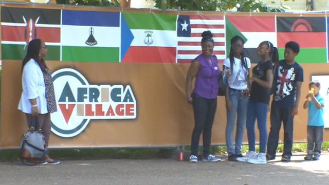 People outside Africa village
