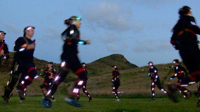 Runners on Edinburgh's Arthur's Seat