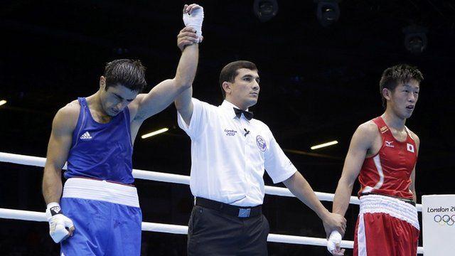 Azerbaijan's Magomed Abdulhamidov is declared the winner over Japan's Satoshi Shimizu in boxing match
