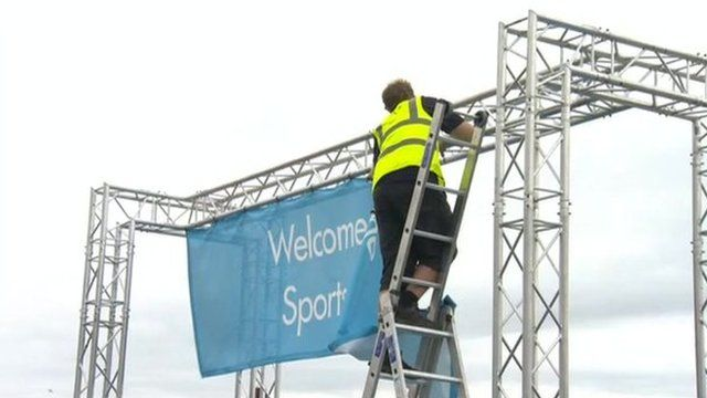 Worker removing Olympic banners