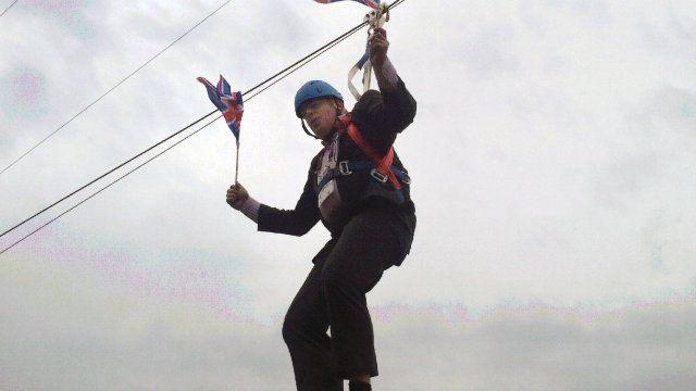 Boris Johnson dangles from a zip wire