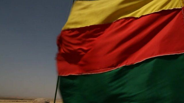 A Kurdish flag flies again in north-eastern Syria