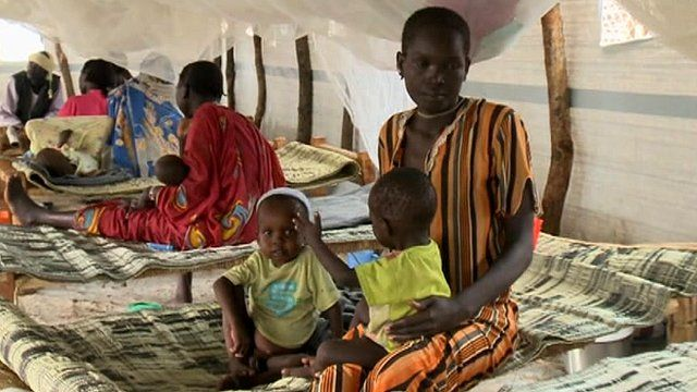 A mother with her two children at Batil refugee camp