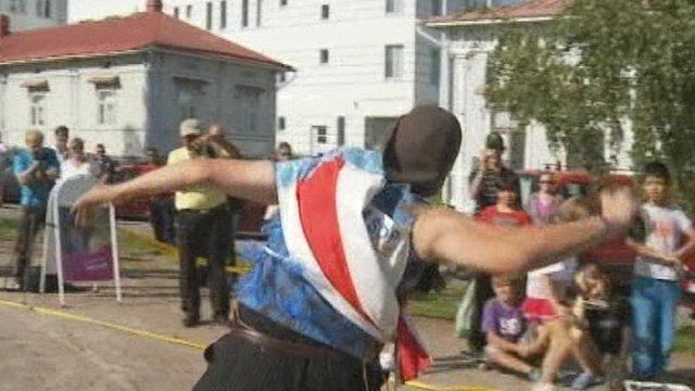 Mobile phone throwing competitor